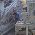 Начались работы по очистке подпорной стены лестницы.
